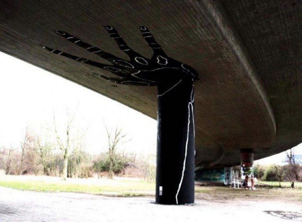 Hand Holding Overpasses