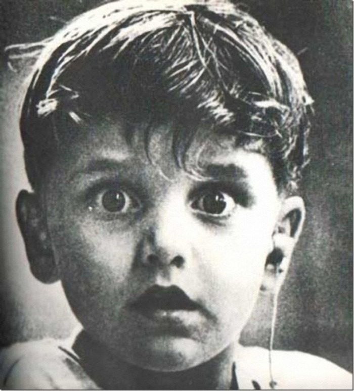 Harold Whittles hears the first sounds in his life. A doctor has just set him up a hearing aid