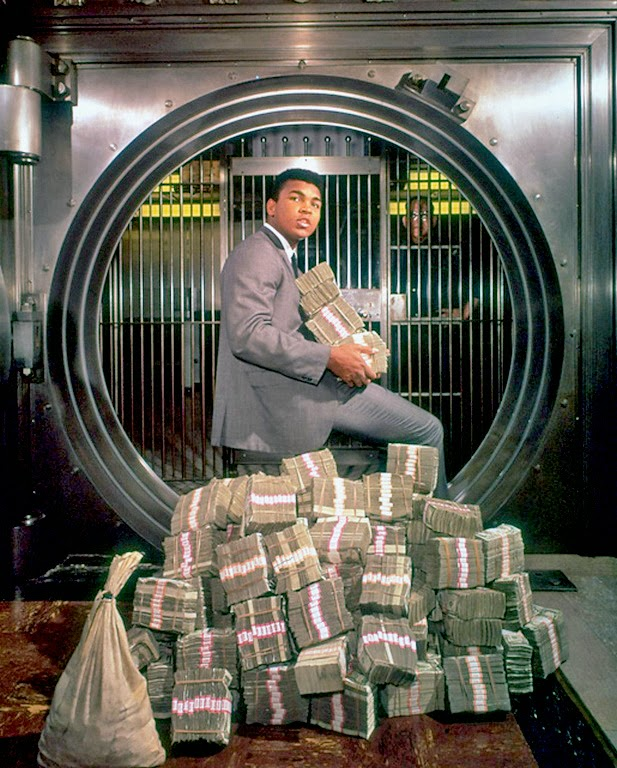 Muhammad Ali with his winnings in 1974