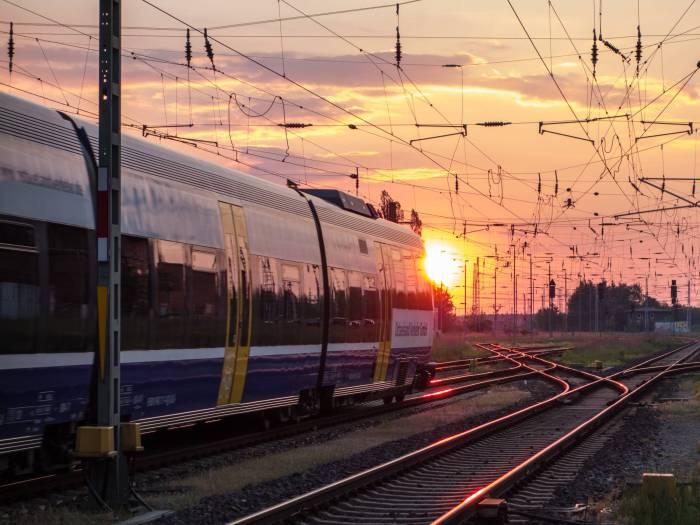 Railroad, train & catenary in sunset [Güstrow, Germany]
