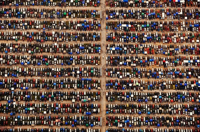 Hundreds of spectators' cars are seen parked at a Nascar event in Richmond, Virginia. Thanks to the angle from which MacLean takes his shots, even the must mundane objects appear abstract and surreal