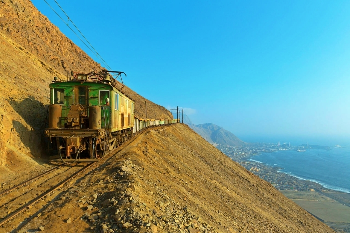 High above Tocopilla, Chile, one of SQMs Boxcabs coasts downhill to the Reverso switchback