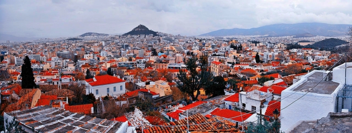 1280px-Panoramic_view_of_Athens_cityscape_(composition_center-_Lykavittos_Hill)._Athens,_Greece