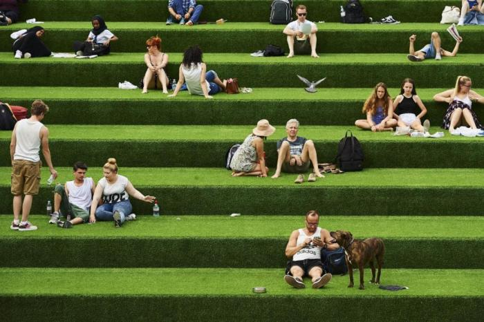 People enjoying the warm weather in central London