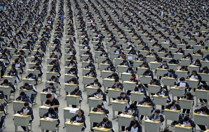 Students take an examination on an open-air playground at a high school in Yichuan, Shaanxi province, China